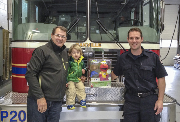 Ray with his grandson supporting Oakville Firefighter's Toy Drive
